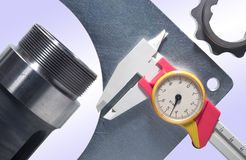 Caliper and mechanical pieces Royalty Free Stock Image