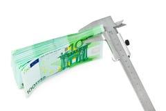 Caliper and money Stock Photos