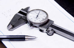 Caliper pen and pad on work table Stock Image