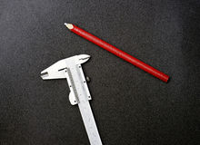 Caliper and red pencil Stock Photography