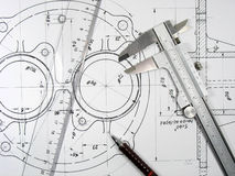 Caliper, ruler and pencil on technical drawings. royalty free stock photo