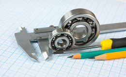 Calipers, bearing and square Stock Photos