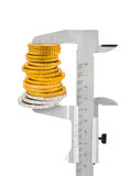 Calipers and stack of coins Stock Photo