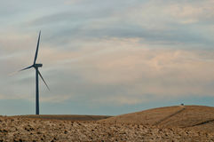 Calironia Windmill. Modern Windmill in northern Califronia next to some people offroading on a lazy sunday afternoon Royalty Free Stock Photo