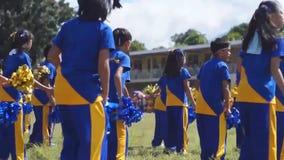 Calisthenics dancers in active performance. Laguna, Philippines - November 21, 2015: public elementary grade school pupils perform dance exercise training for stock video footage