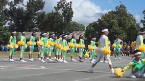 Calisthenics dancers in active performance. Laguna, Philippines - November 21, 2015: public elementary grade school pupils perform dance exercise training for stock video
