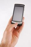 Call 1. Glossy black cell phone in a man's hand Stock Photography