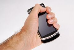 Call 2. Glossy black cell phone in a man's hand Royalty Free Stock Photo