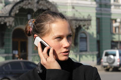 Call. City plot with the young woman Stock Photography