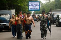 CALL AGAINST PEDOPHILIA. Men call for a moral movement against pedophilia, at Solo, Java, Indonesia royalty free stock images