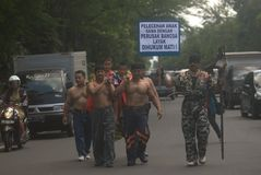CALL AGAINST PEDOPHILIA. Men call for a moral movement against pedophilia, at Solo, Java, Indonesia stock photography