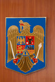 Call of arms. The Romanian call of arm on a wood background Royalty Free Stock Photos