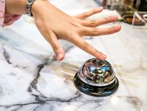 Call bell in restaurant vintage with hand service granite background luxury. stock images