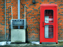 Call booth and filling pump. Telephone and petrol with a brick wall Royalty Free Stock Photos