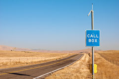 Call Box off Highway. Emergency call box sits off to the side on a rural highway royalty free stock photography