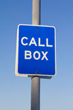 Call box sign. Blue call box sign in pole stock photos