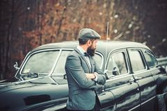 Call boy in vintage auto. Bearded man in car. Travel and business trip or hitch hiking. Retro collection car and auto stock photos