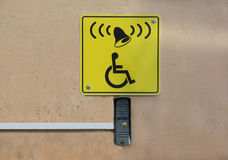 Call button and sign with a picture of a wheelchair Stock Photography