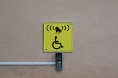 Call button and sign with a picture of wheelchair Royalty Free Stock Photography