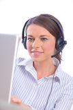 Call center. Beautiful woman with headset working in call center Stock Photos