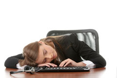 Call center. Young beautiful caucasian woman working in call center, sleeping on desk Royalty Free Stock Photos