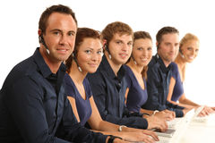 Call-center. Six young people sitting in a call-center stock photos