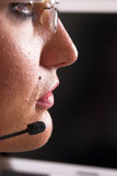 Call center. Face of young woman with headset Royalty Free Stock Images