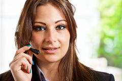 Call center. Portrait of a beautiful call center employee Stock Photos