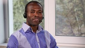Call Center Advises. The call center operator conducts consultations. He answers questions from clients stock video footage