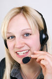 Call Center Agent. Having a telephone call and types on computer Royalty Free Stock Images
