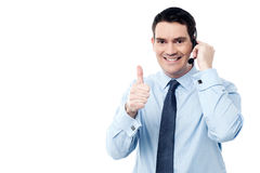 Call center agent showing thumb up Royalty Free Stock Photo