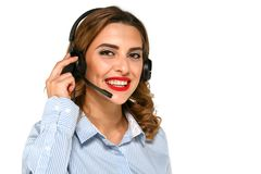 Call-center agent speaking with clients using headset. Adorable smiling woman, call center agent speaking with someone using headset on a white background Royalty Free Stock Images