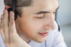 Call center agent talking to a client. Using headset Stock Photo