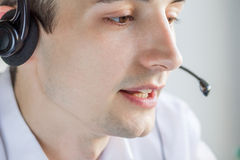 Call center agent talking to a client. Using headset Royalty Free Stock Image
