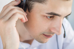 Call center agent talking to a client. Using headset Royalty Free Stock Images