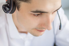 Call center agent talking to a client. Using headset Stock Photos