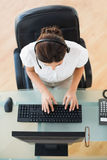 Call center agent typing while on a call Stock Images