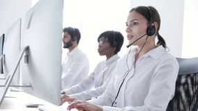 Call Center Agents Consulting Clients On Hotline At Office