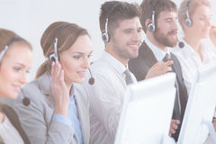 Call center agents. Group of call center agents focused at work royalty free stock photos