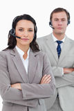 Call center agents with headsets and arms folded Royalty Free Stock Photography