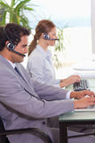Call center agents at work Stock Images