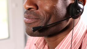 Call Center Answers Customer Questions. The call center employee answers questions from clients. He conducts business consultations stock video