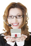 Call center assistant woman with house model Stock Photography