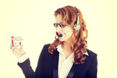 Call center assistant woman with house model Stock Photos