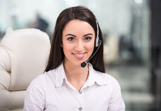 Call center. Attractive young woman is working in a call center Stock Photos