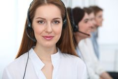 Call center. Beautiful cheerful smiling operator consulting clients with headset. Business concept of customer service.  royalty free stock photos