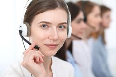 Call center. Beautiful cheerful smiling operator consulting clients with headset. Business concept of customer service.  stock photo
