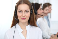 Call center. Beautiful cheerful smiling operator consulting clients with headset. Business concept of customer service.  stock image