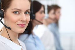 Call center. Beautiful cheerful smiling operator consulting clients with headset. Business concept of customer service.  stock images