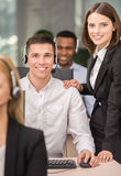 Call center. Beautiful female manager helping call centre agent Royalty Free Stock Photo